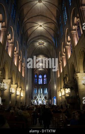 Main nave inside Notre Dame de Paris cathedral - Paris, France - Stock Image