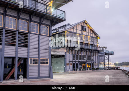old warehouse on a wharf on sydney harbour - Stock Image