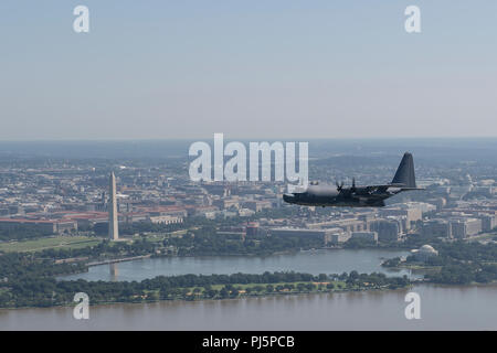 An AC-130U Spooky gunship, MC-130H Combat Talon II and two CV-22 Osprey tiltrotor aircraft assigned to the 1st Special Operations Wing, Hurlburt Field, Florida, fly over the Air Force Memorial, Aug. 24, 2018, in Arlington, Virginia. The flyover was performed during a ceremony honoring U.S. Air Force Tech. Sgt. John Chapman, a Special Tactics combat controller, who was posthumously awarded the Medal of Honor for his extraordinary heroism during the Battle of Takur Ghar in March 2002 while deployed to Afghanistan.  Chapman is the 19th Airman to receive the Medal of Honor and the first Airman to  - Stock Image