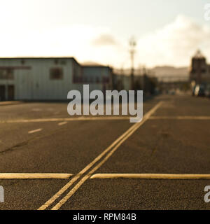 Road With Double Yellow Lines and Speed Bumps - Stock Image