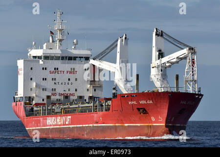 General cargo vessel HHL Volga inbound the Kiel Fjord. - Stock Image
