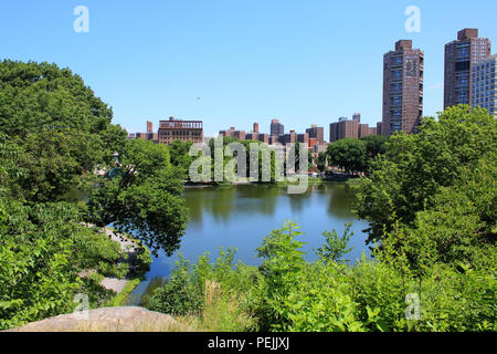 North facing view of Harlem Meer from the top of Fort Clinton in Northern Central Park, Manhattan - Stock Image
