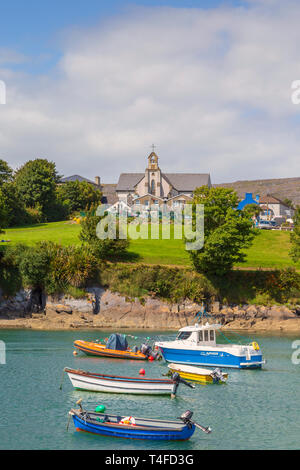 Schull, County Cork, Republic of Ireland.  Eire.  The harbour and St. Mary's church. - Stock Image