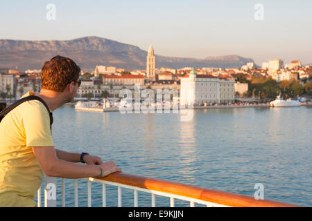 TOURIST ON BOAT MOORED AT SPLIT TOWN - Stock Image