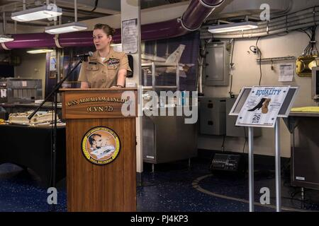 180829-N-TT202-015  ATLANTIC OCEAN (Aug. 29, 2018) Chief Aviation Ordnanceman Gretchen Jackson speaks during the Women's Equality Celebration in the aft mess decks of the Nimitz-class aircraft carrier USS Abraham Lincoln (CVN 72). Abraham Lincoln is underway with Carrier Strike Group 12 (CSG 12) conducting Operational Test-1 (OT-1) for the F-35C Lightning II Joint Strike Fighter. (U.S. Navy photo by Mass Communication Specialist 3rd Class Daniel E. Gheesling/Released) - Stock Image