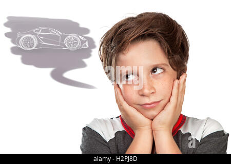 Closeup portrait of a cute teen boy dreaming about a car, thoughtful child isolated on white background, great boyish - Stock Image