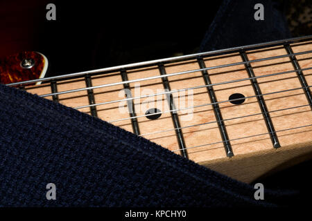 Electric guitar frets, strings & pickup - Stock Image