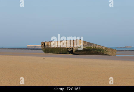 Arromanches-les-Bains,Normandy, France, March,27, 2019, Remains of the Mulberry Harbour build by the  allies in June 1944 as seen on the beach today - Stock Image