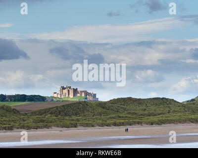 Bamburgh Castle and beach. - Stock Image
