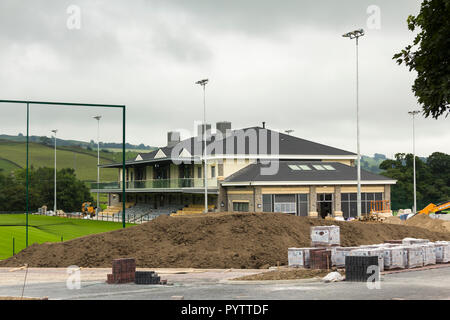 Spectator stand and extensive clubhouse facilities costing £10m, nearing completion at Mint Bridge, the new rugby union football ground in Kendal. - Stock Image
