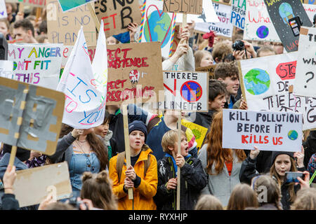 Bristol, UK. 15th March, 2019. Bristol college students and school children carrying climate change placards and signs are pictured as they protest outside Bristol City Hall. The pupils who also went on strike last month walkedout of school again today as part of a countrywide coordinated strike action to force action on climate change policy. Organisers of the UK Youth Strike 4 Climate movement say that pupils from more than 100 towns and cities across the UK will skip classes today and will instead protest against climate change. Credit: Lynchpics/Alamy Live News - Stock Image