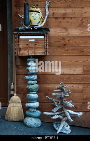 Village style created with river boulders and driftwood at an alpine chalet at Ferden in the Loetschental, Valais, Switzerland - Stock Image