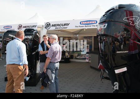 Southampton, UK. 11th September 2015. Southampton Boat Show 2015. Visitors to the Mercury stand speak with an exhibitor - Stock Image