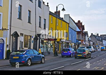 A street view of the High Street in the Welsh market town of Cowbridge, with it's mix of famous brands and small local specialist shops. - Stock Image