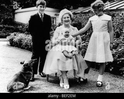 The Queen Mother, Elizabeth Bowes-Lyon, with her grandchildren Prince Charles, Princess Anne, and Prince Andrew - Stock Image
