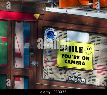 Warning sign on cabin of fishing boat monitored by video camera - Stock Image