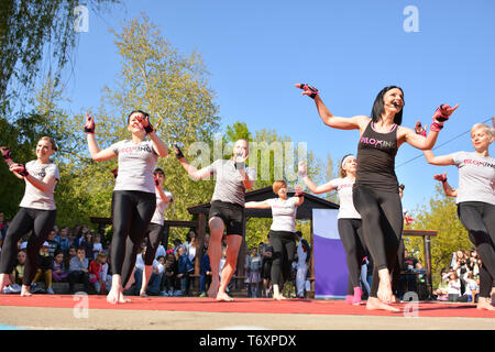 Nis, Serbia - April 20, 2019 Young people gathered to perform Piloxing training during the day, outdoor sport activities on sunny spring day - Stock Image