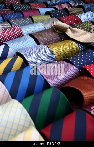 Collection of ties on hangers in men clothing store. - Stock Image