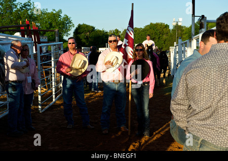Members of PRCA rodeo singing their national anthem in Smalltown, Bridgeport, Texas, USA - Stock Image