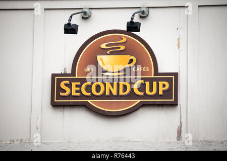 MONTREAL, CANADA - NOVEMBER 5, 2018: Second Cup Coffee logo in front of their local cafe in downtown Montreal, Quebec. Second Cup Coffee is a Canadian - Stock Image