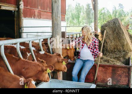 Pregnant woman on farm - Stock Image