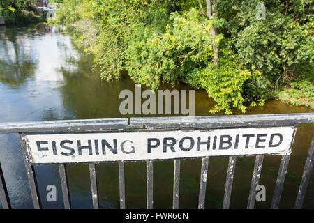 Fishing prohibited sign on the bridge over the River Avon at Fordingbridge, Hampshire. - Stock Image