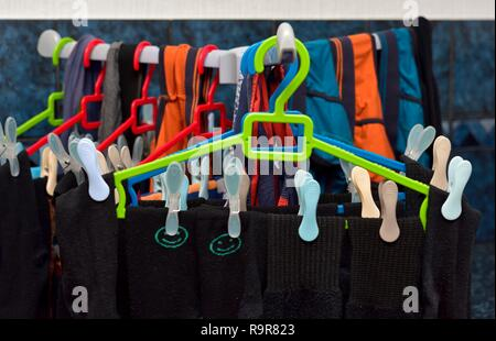 washing hanging up to dry indoors - Stock Image