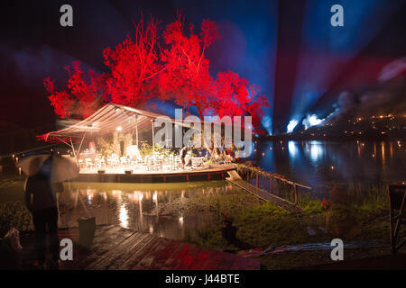 Floating Orchestra over water - Leigo Lake Music Festival - Stock Image