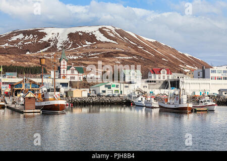 13 April 2018: Husavik, North Iceland - The church, harbour and town centre. - Stock Image