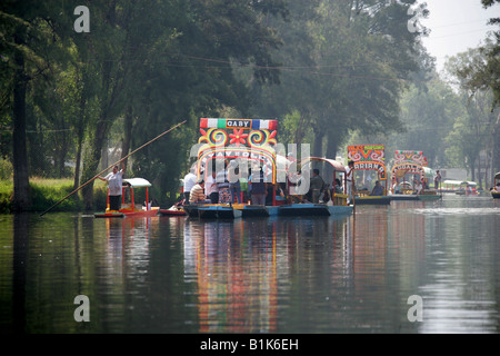 Boats on the Canals of the Floating Gardens of Xochimilco Mexico City Being Serenaded by a Mariachi Band - Stock Image