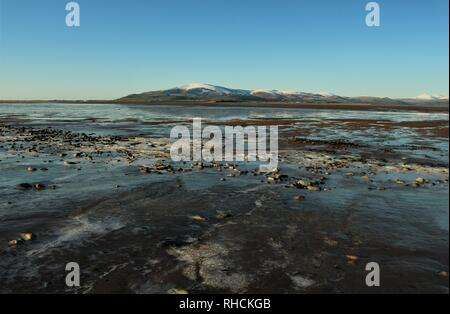 Sandscale Haws Cumbria UK. 2nd February 2019. UK Weather. Cold and clear day from the Cumbrian Coast. View across the Duddon Estuary towards the distant English Lake District. Credit C.Hall / Alamy Live News. - Stock Image