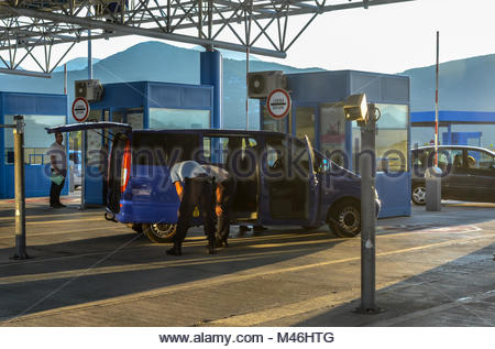 A van is stopped and checked by two inspectors at the border crossing at Ivanica between Bosnia and Herzegovina - Stock Image