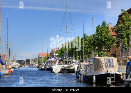 Moored yachts, boats and leisurecraft on Christianshavns Kanal, Overgaden, Christianshavn, Copenhagen, Zealand, Denmark - Stock Image