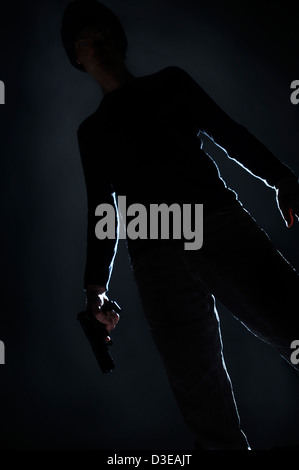 Man with gun - Stock Image