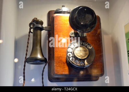 Wall telephone type 121, from the 1920s, in the Connected Earth Exhibition at the Milton Keynes Museum, Wolverton, Buckinghamshire, UK - Stock Image