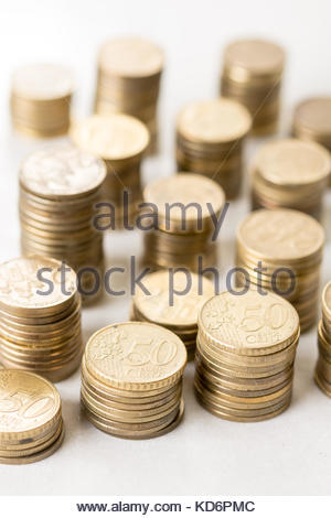 Piles of metal euro money coins with blurred background. - Stock Image
