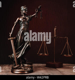 Law offices of lawyers legal statue Greek blind goddess Themis bronze metal statuette figurine with scales of justice. - Image - Stock Image