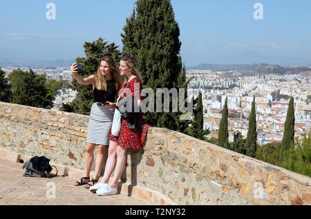 Spain selfie - two women tourists taking a selfie, Malaga Castle, Malaga old town, Andalusia Spain Europe - Stock Image