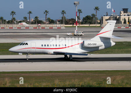 Dassault Falcon 2000EX business jet operated by Luxaviation (formerly Abelag) taking off from Malta - Stock Image