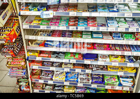 Miami Beach Florida South Beach convenience store inside sale display chewing gum candy bars snacks m&m's - Stock Image