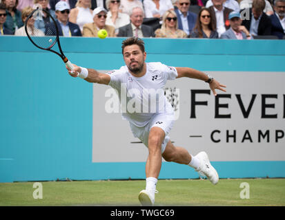 The Queens Club, London, UK. 20th June 2019. Day 4 of The Fever Tree Championships. Number 7 seed Stan Wawrinka (SUI) is knocked out by Nicolas Mahut (FRA) on centre court, Mahut winning 3-6;7-5;7-6 (7-2). Credit: Malcolm Park/Alamy Live News. - Stock Image