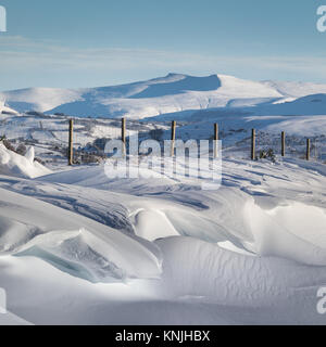 Paxton's Tower. UK. 11th December, 2017. Huge snow drifts looking across the Brecon Beacons National Park towards - Stock Image