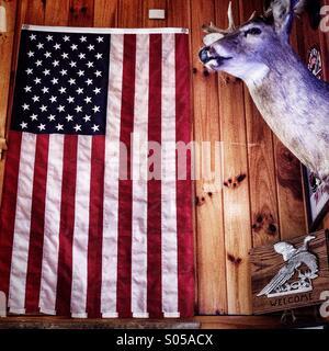 American flag and stuffed deer. Nova, ohio. - Stock Image