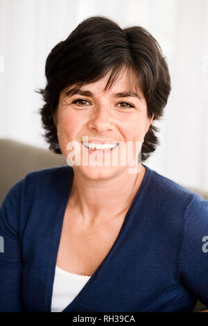 Portrait of smiling woman - Stock Image