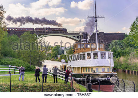 Duchess of Sutherland steam locomotive pictured crossing the river Weaver at Frodsham junction, Sutton Weaver on the 2019 Great Britain Railtour. with - Stock Image
