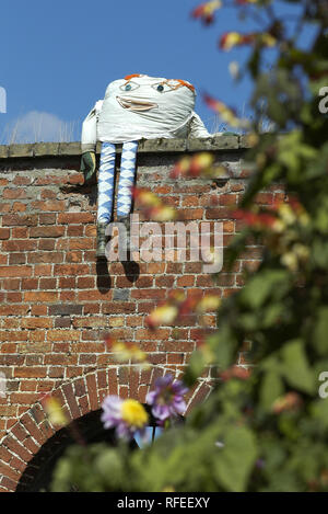 Humpty Dumpty sitting wall garden walled perched seated - Stock Image