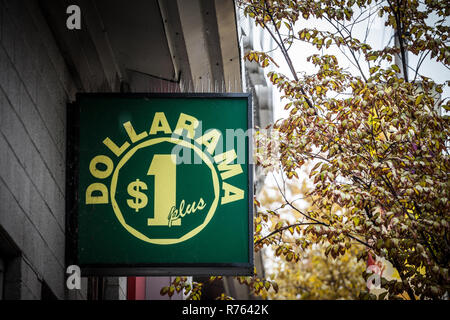 MONTREAL, CANADA - NOVEMBER 5, 2018: Dollarama logo in front of their local shop in downtown Montreal, Quebec. Dollarama is a Canadian chain of hard d - Stock Image