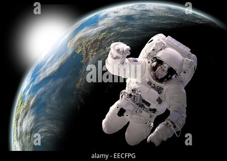 Artist's concept of an astronaut floating in outer space. An Earth-like planet sees sunrise in the background. - Stock Image