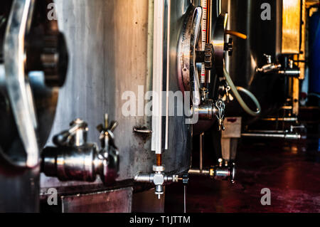 vinery facility silos factory background faucet close up  - Stock Image