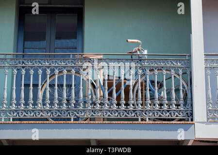 A bicycle stored on the front veranda of a double story (storey) terrace house in Surry Hills, Sydney Australia - Stock Image